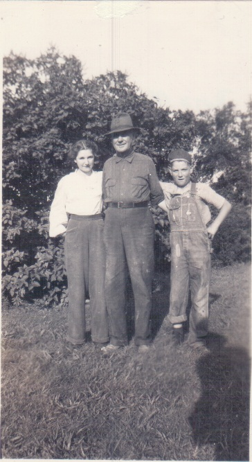 Viola, Napoleon and John William Maddox on the farm.