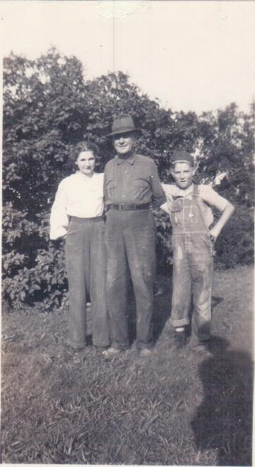Viola, Napoleon and John William Maddox on the farm.